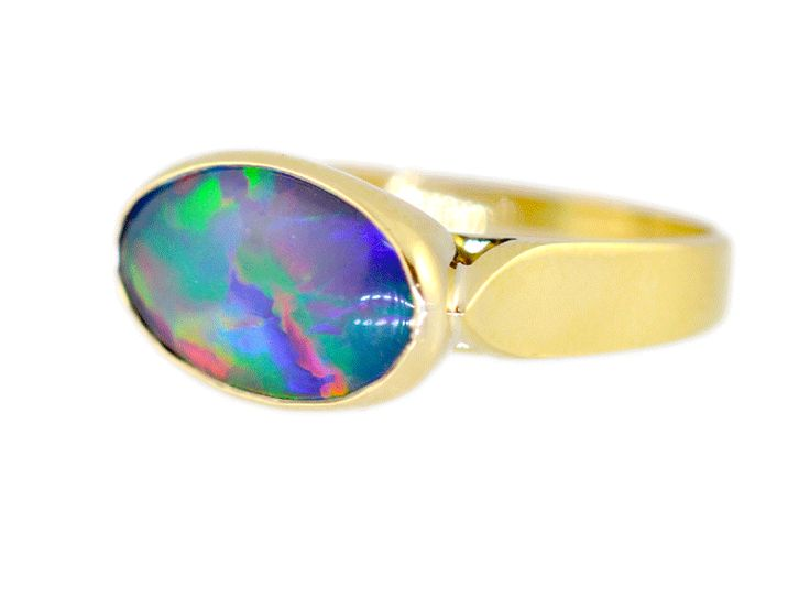 Solid opal and yellow gold ring