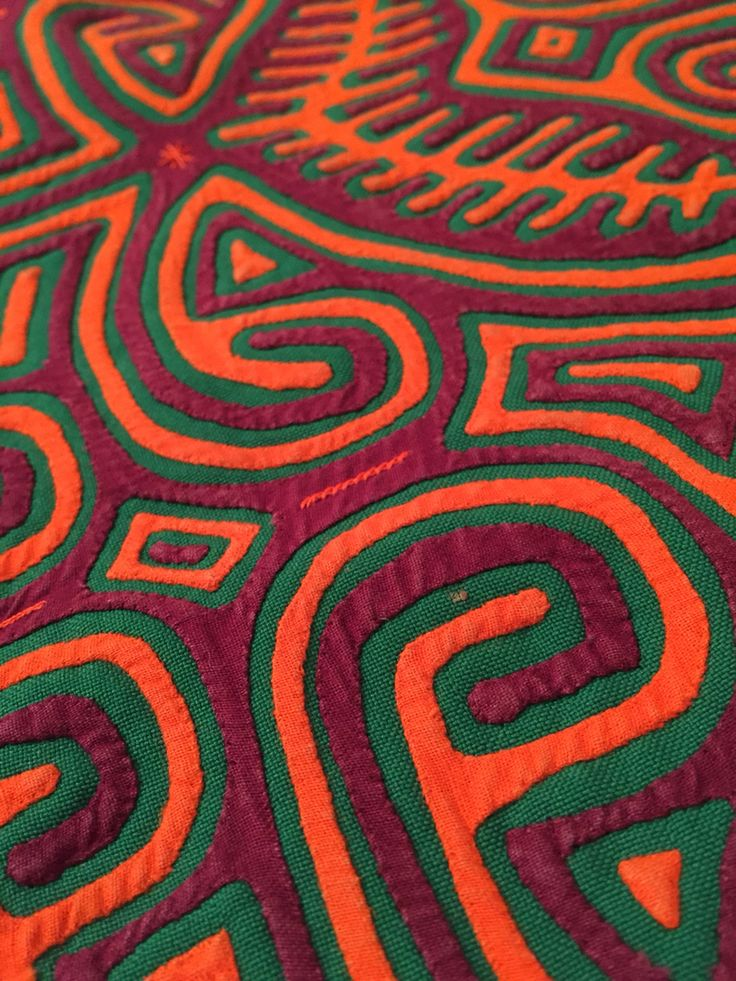 Mola from Northern Colombia. Molas are chiefly found in Colombia and Panama. They are made of layers of fabric, known as appliqués.
