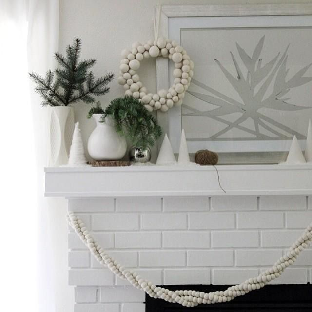 A snow-day-style holiday mantle by @hankandhunt – feat. our Felt Ball Wreath + Felt Garland + more! #mywestelm #deckthehalls