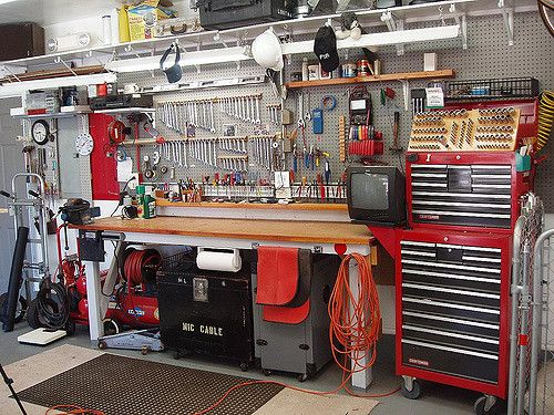 Hand tools on the north wall, duplicate tool chest with sockets, ratchets and extensions.   Overhead storage.