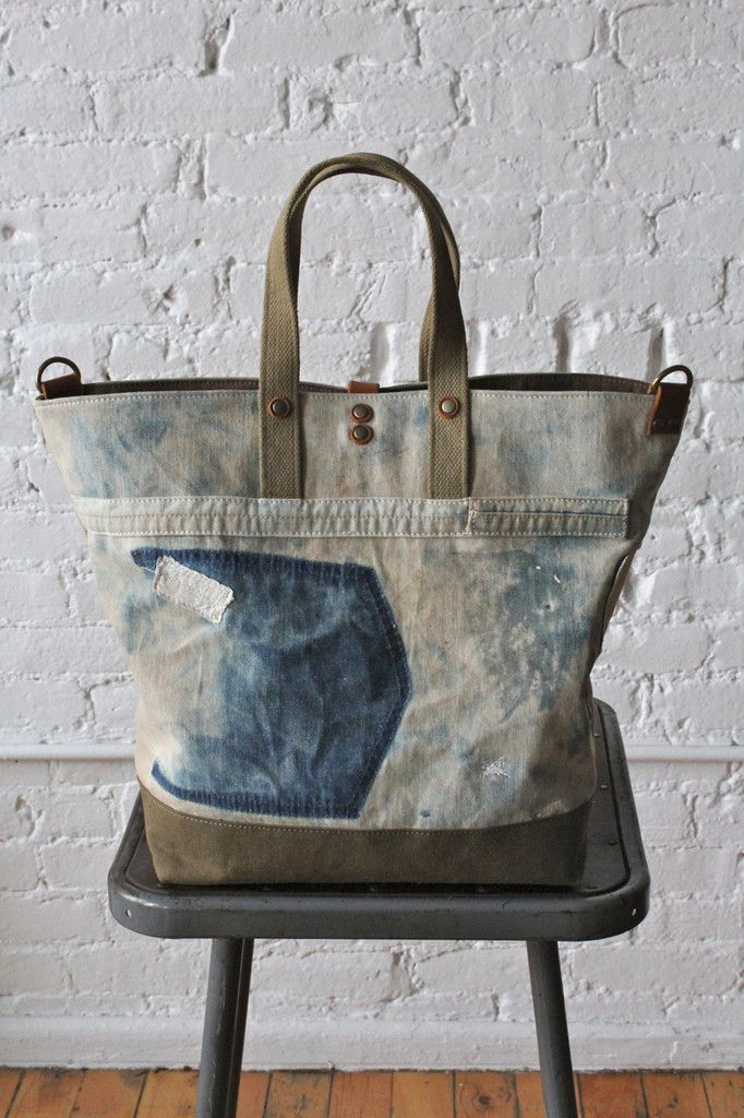 2. The material used to construct this bag is over 80 years old but still in the most wonderful condition. Many of the original elements from the apron have been included in this tote to highlight the unique nature of the material. Any discoloration of the fabric is the result of many years of natural wear and aging.