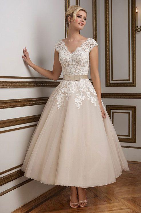 A 1950's vintage inspired V-neckline tulle tea length ball gown rich in hue. Justin Alexander, Spring 2016