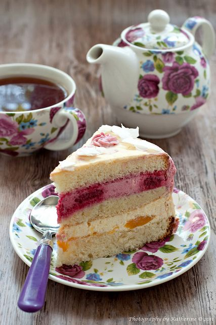 Love the tea pot, cup and saucer... the Rasberries and Peaches cake looks yummy too :)