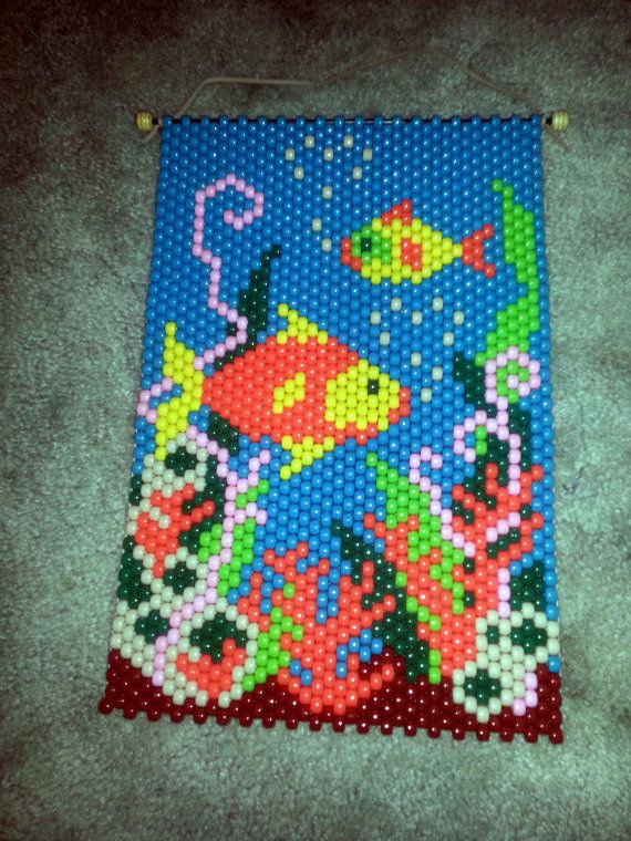 Beaded banner fish scene. Very colorful and makes a great wall decoration. Approximate size is 14 x 9 1/2. Would look good in a childs room.