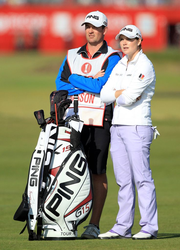 Caroline Masson Photos Photos - Caroline Masson of Germany lines up a shot with caddie Martin Ridley during the third round of the 2011 Ricoh Women's British Open at Carnoustie on July 30, 2011 in Carnoustie, Scotland. - Ricoh Women's British Open - Day Three