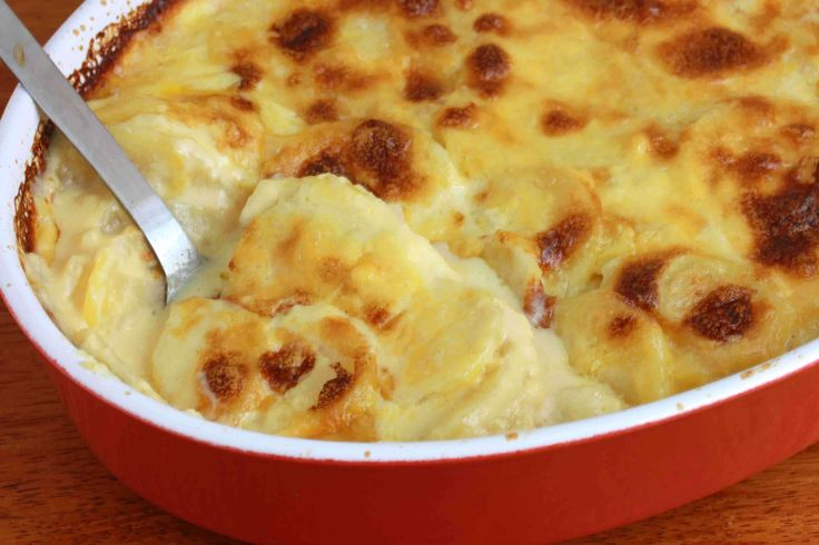 These creamy au gratin potatoes are luscious with oozing cheesy cream sauce. Easy to make and the perfect side dish.