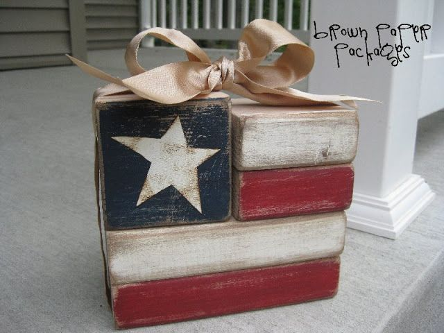 American Flag Blocks ~ inexpensive home decor or thrifty gifts I saw on HowDoesShe.com.  I put my own spin on these blocks, opting for a painted, distressed look, and LOVE the way it looks!