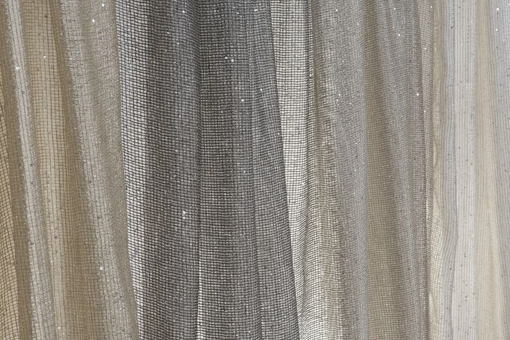 """Luces,"" meaning lights, literally sparkles. A star of this Fall 2013 Matador Mystique line, this lino sheer has silver sequins throughout adding a playful and subtle shine."