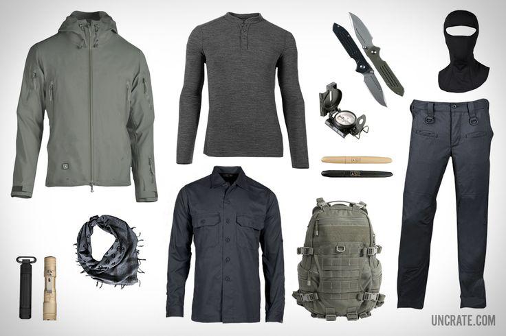 TAD Stealth Hoodie LT ($475). TAD Overland Shirt ($89). TAD Huntsman 200 Henley ($99). TAD Fast Pack EDC Backpack ($325). TAD T-Skull Shemagh ($19). TAD Life Capsule Omega ($85). Fisher Space Pen 400 TAD Edition ($22). LensLight 2X123 TAD Edition Flashlight ($189). Dauntless-MK2-G10 Knife ($300). TAD Covert Pant RS ($109). TAD Nemesis Balaclava ($40).