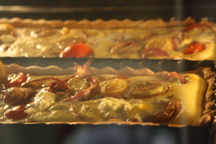 Tomato and mozzerella tart baking away....