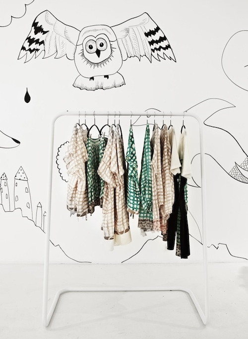 tsumori chisato pop up shop Love the simple illustration, white floor,  white hanging rods. Color coming from merchandise.  So sharp! PopUpRepublic.com