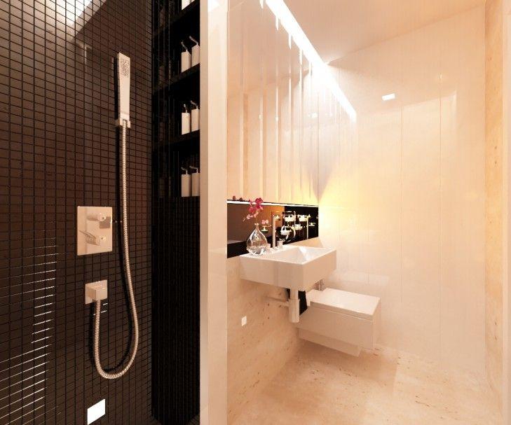 Aranżacja niewielkiej toalety w stylu nowoczesnym z elementami klasyki. Pomieszczenie wykończone trawertynem, skontrastowanym z czarną, błyszczącą mozaiką na ścianie prysznica.