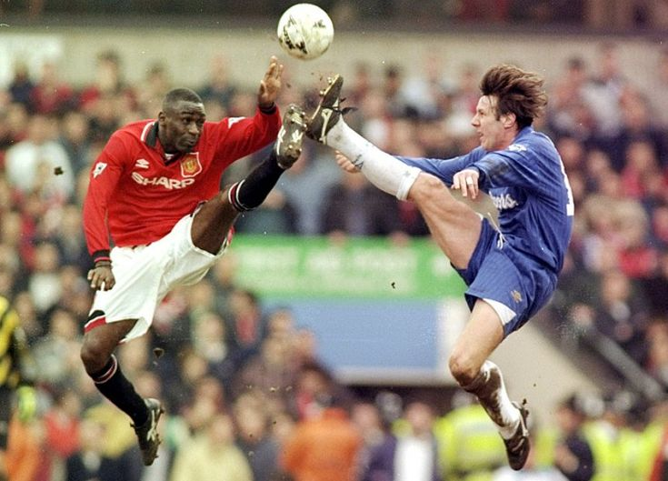 Andy Cole of Manchester United and Craig Burley of Chelsea jump for the ball during the 1996 FA Cup Semi-Final