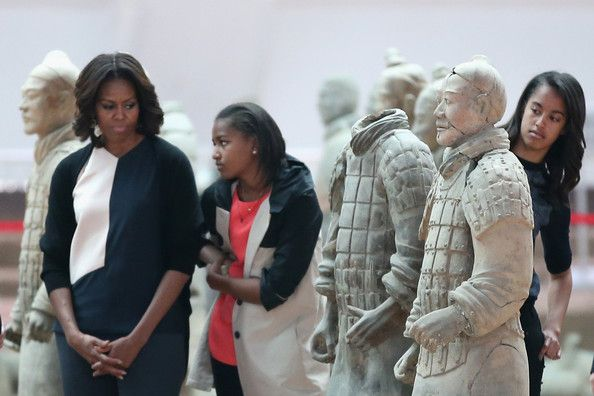 Michelle Obama Photos - First Lady Michelle Obama (Left) with her daughters Malia Obama (Right) and Sasha Obama (Center), mother Marian Robinson visit Museum of Terracotta Warriors during a visit to the historic excavation site on March 24, 2014 in Xi'an, China. Michelle Obama's one-week-long visit in China will be focused on educational and cultural exchanges. - Michelle Obama Photos - 2671 of 9409