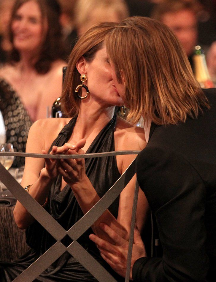 Pin for Later: 31 Times Brad Pitt and Angelina Jolie Showed Their Love For Each Other (and the Cameras!)  The couple kissed during the January 2012 SAG Awards.