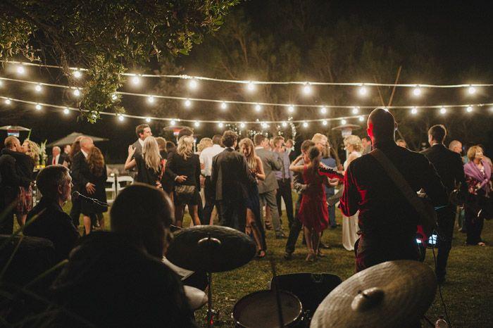 Katy & Mike – Marlowe House, Woolgoolga, NSW » Coffs Harbour Wedding Photographer | David Moore- Produced by North Coast Luxury Weddings www.northcoastluxuryweddings.com - evening wedding outdoors with festoon party lights