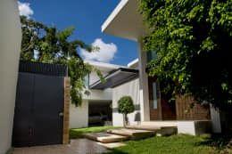 Casas modernas por AIDA TRACONIS ARQUITECTOS EN MERIDA YUCATAN MEXICO