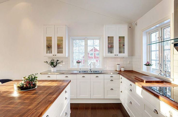 white cabinets and wooden floor.