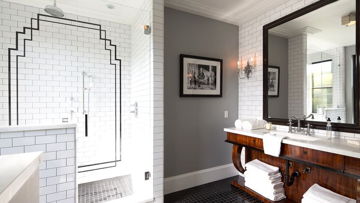 love the minor details along with the great ones - custom subway tile design, accent wall, black flooring, exposed plumbing (vintage - industrial) design.