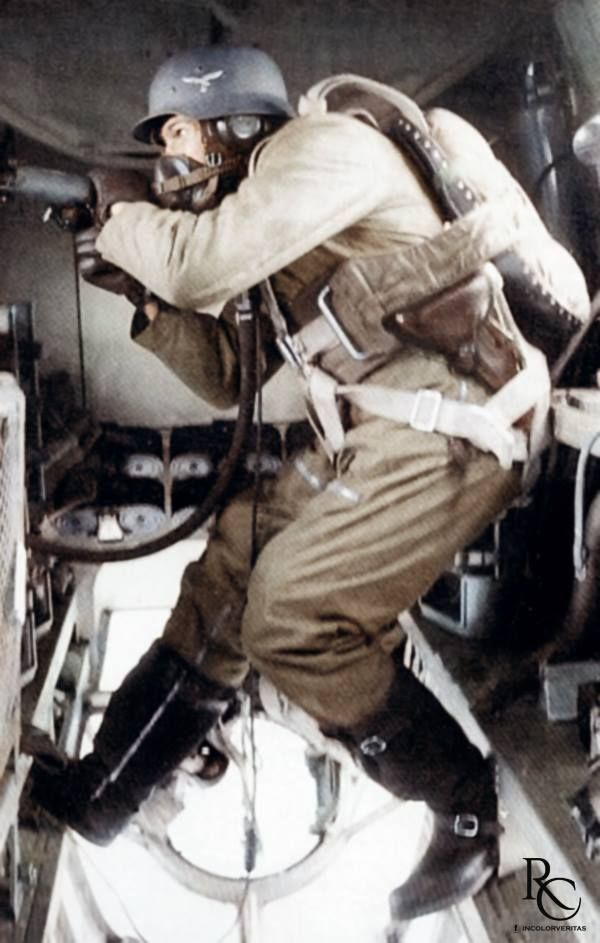 Photo study of a Heinkel He 111's waist gunner manning a 7.92mm MG 15. After an unexpected high number of losses during the Polish Campaign, in 1940 the He 111's defensive armament was increased to a new total of 5 defensive MGs with the addition of two waist MG 15. Unfortunately for the crew, due to the lack of space there was only one waist gunner operating both the port and starboard machine guns. This restriction made defending the aircraft against simultaneous attacks from port and…