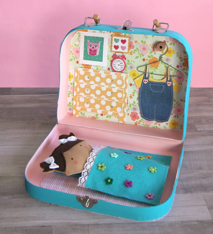 Make an adorable miniature dollhouse inside a little suitcase. The perfect handmade gift for that special little girl in your life and a great way to organize a doll and her doll clothes.
