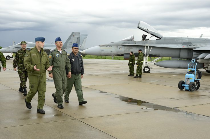 Tail Number (734 & 788): Lieutenant-Colonel Darcy Molstad, Canadian Air Task Force Commander, Lieutenant General Ştefan Dănilă, Romanian Chief of General Staff and Commander Marian Petrus, base Commander, discuss international cooperation on the airfield in Câmpia Turzii, Romania during NATO reassurance measures on May 15, 2014.   Photo by MCpl Patrick Blanchard, Canadian Forces Combat Camera (IS2014-3025-03)
