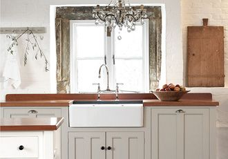 Love the simple style & colour of this English kitchen