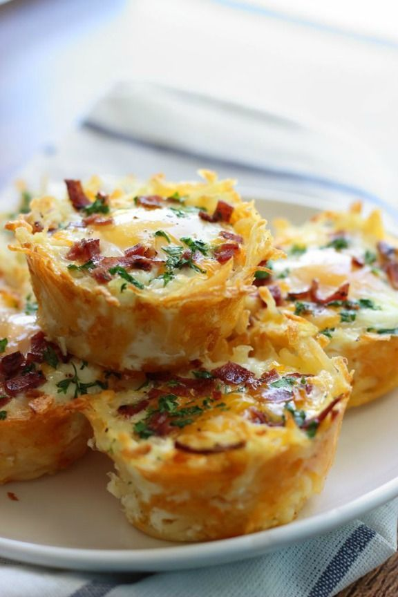 These hash brown egg nests with avocado make us hungry just looking at them.