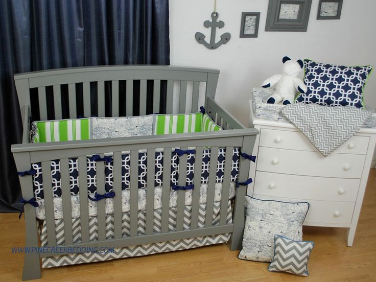 Green And Navy Geometric Crib Bedding In A Nautical Theme Nursery With Grey Chevron