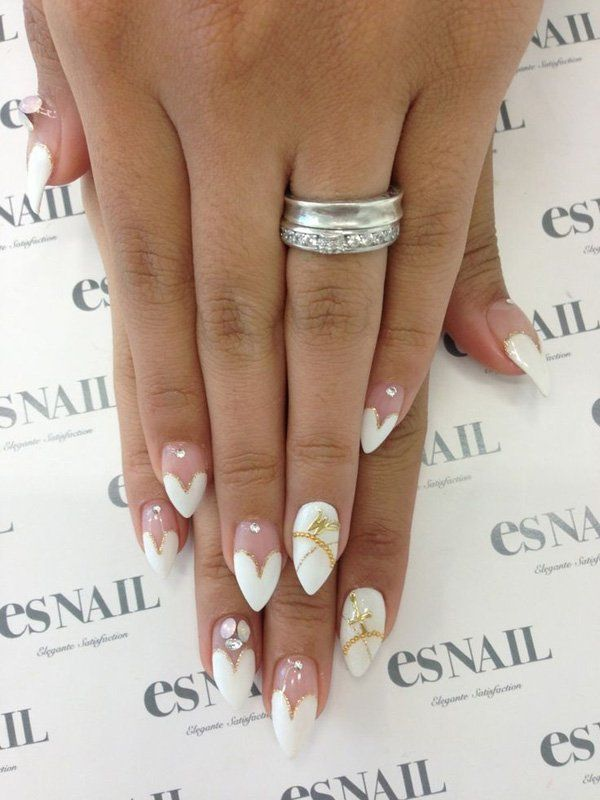Purity inspired nail art with white heart shapes on the nail tips, simple yet elegant. Shades of white and silver beads are popular because they can easily match your outfit whatever occasion it may be. The simplicity of the nails also emphasizes its beauty without overshadowing the wearer. This is a great design for women who tend to be conservative yet still want to be fashionable.