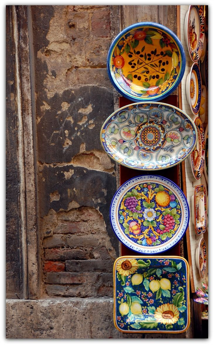 Via Banchi di Sopra  Colorful ceramics in a shop doorway in Siena, Italy