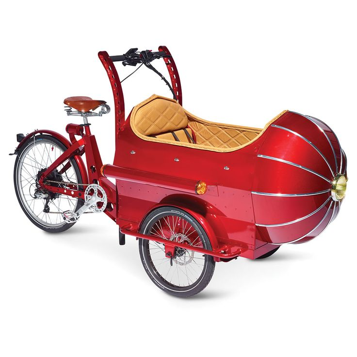 The Victorian Futurist's Electric Cycle - Hammacher Schlemmer. This is the electric tricycle made in England that evokes the spaceflight-inspired fantasy of H.G. Wells and Jules Verne with a rocket-shaped nosecone that forms its passenger section. Only available from Hammacher Schlemmer and powered by a 36-volt rechargeable battery, the tricycle's 500-watt electric motor provides assisted pedaling in addition to a seven-speed dérailleur for purely human-powered operation.