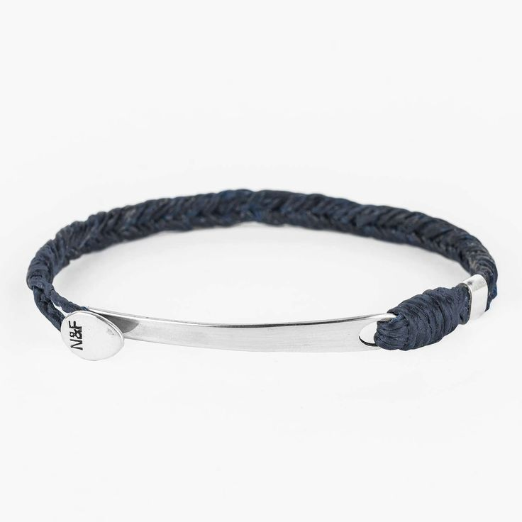 Steve Navy is a large fish hook bracelet in a nice dark navy blue color with a fishbone braid.     A handmade and unique bracelet for everyday use. Water and sun enduring, with colour-safe waxed cotton strap and details in Sterling silver 925. Easy to mix and match.     Materials: Waxed cotton and Sterling silver. Braid: Fishbone Size: Please choose your correct size by measuring you wrist and find the correct length for you. We offer small, medium, large and XL.