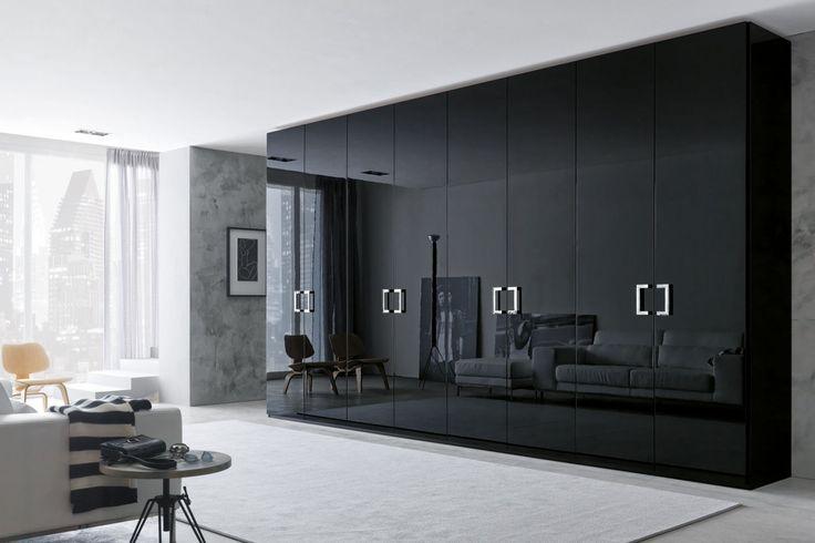 Latest-Stylish-Wardrobe-Design-2015-with-Modern-Black-Shine-Wardrobe-Design-Grey-Carpet-and-Minimalist-Table