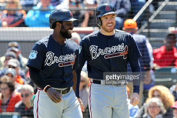Brandon Phillips and Freddie Freeman fo the Braves are all smiles after scoring during the spring training game between the Atlanta Braves and the Detroit Tigers on March 15, 2017 at Joker Marchant...