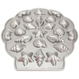 The Sea Shell Teacakes Pan by Nordic Ware is sure to make some waves at your next celebration. The Nordicware Sea Shell Teacakes Pan is non-stick, cast aluminum pan featuring 23 individual indentations shaped like cone and spiral seashells, seahorses, and starfish.