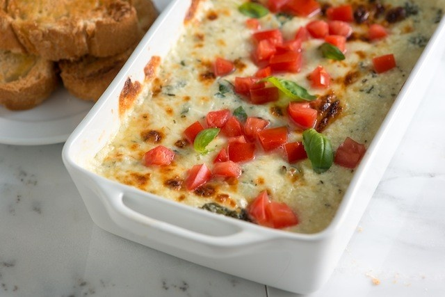 Baked Cheese Dip with Tomato and Basil served with baguettes