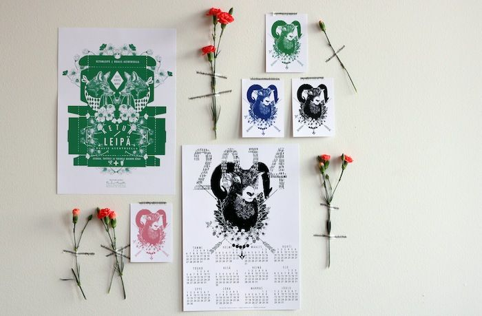 Flowers, cards and calendar on wall.