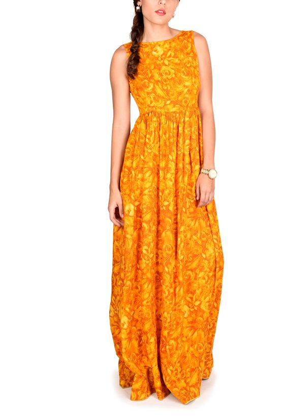 Don your freshest look this summer with True Browns' fashionable yellow floral dress in cotton. The happy coloured florals are just perfect for a sunny day! The flared full-length dress is prettily gathered at the waist and fits marvelously enhancing your figure so well that it flatters you at every angle.