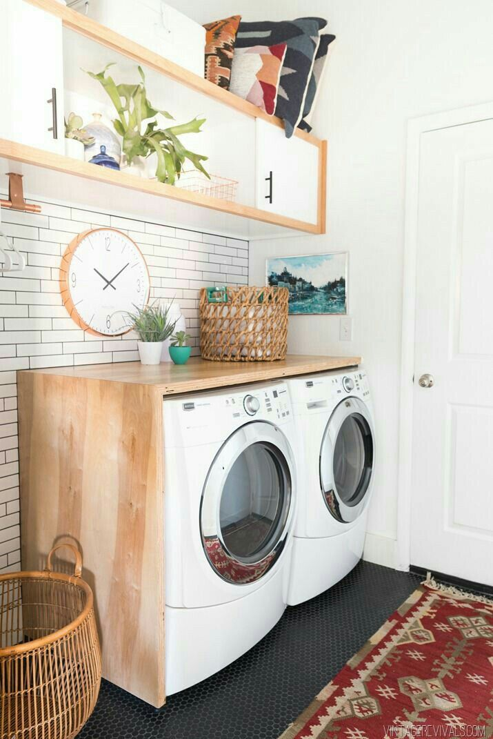 Skinny subway tile and wood shelving in this laundry room space. small honeycomb tile on the floor. Home decor blogger. Interior decorating