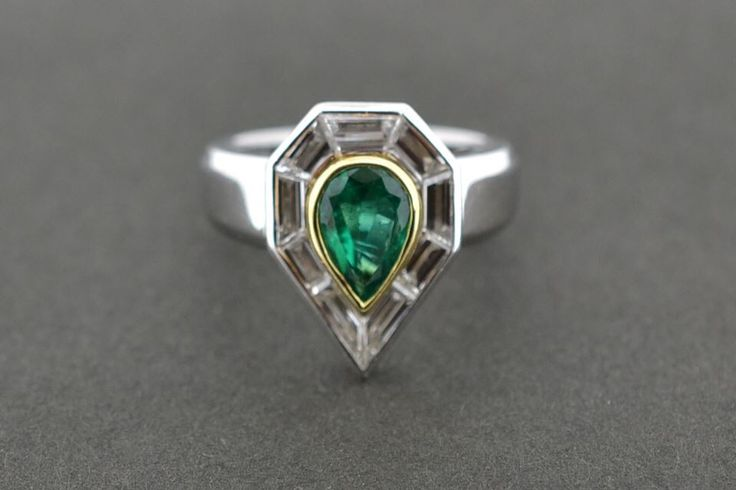 Colombian natural emerald set in platinum with a baguette cut diamond surround.
