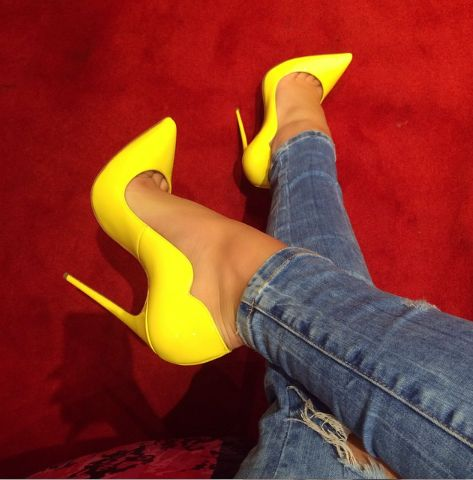 Step into our sexy 'Lola' yellow patent leather pump. The Lola pump features a scallop side detail, pointed toe and stiletto heel for a polished, sophisticated and sexy look. Available in other colors