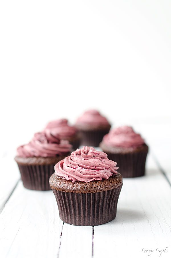 chocolate cherry cupcakes topped with a light meringue-based cherry buttercream//