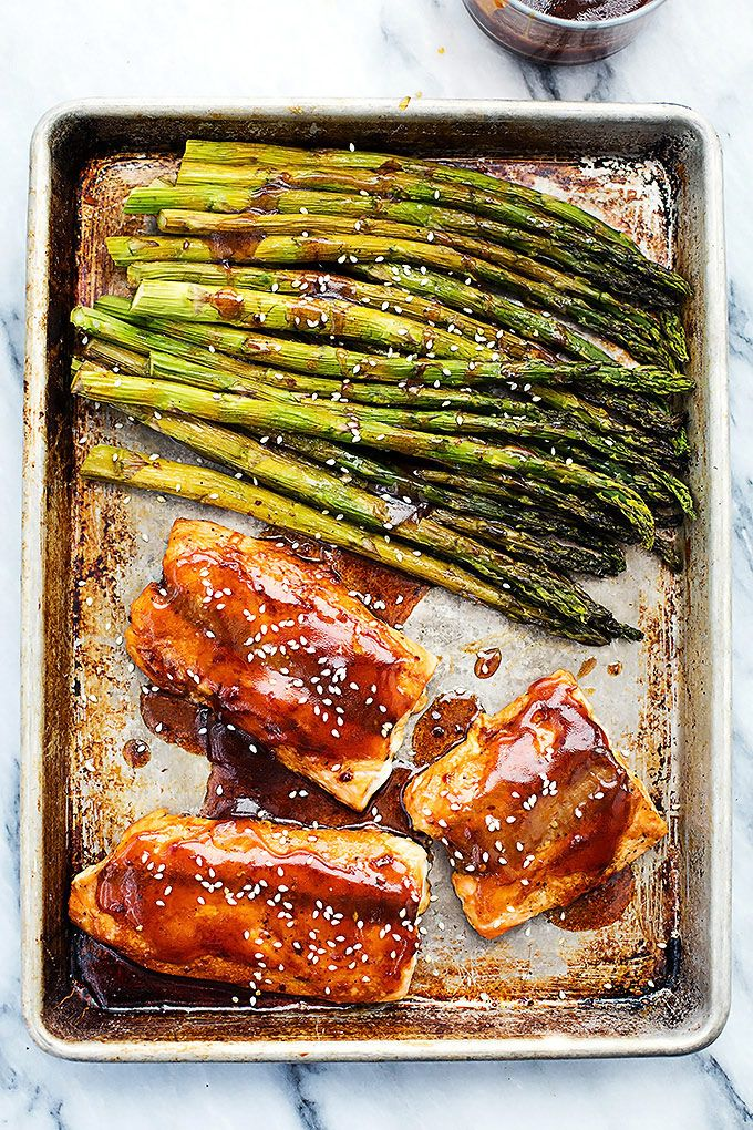 """Easy oven baked salmon and asparagus with a sweet and savory sesame glaze. Are you a fish person? I don't like """"fishy"""" fish – the kind that you can smell a mile away and tastes like the water it came from (hello lake trout) unless it is cooked in some really spectacular way that takes …"""