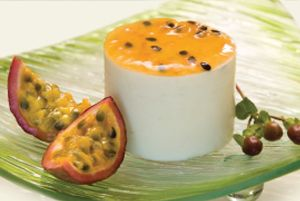 Granadilla Cheesecake: Tangy and smooth granadilla cheesecake made with granadilla pulp on a shortbread crumb base, topped with passion fruit coulis.