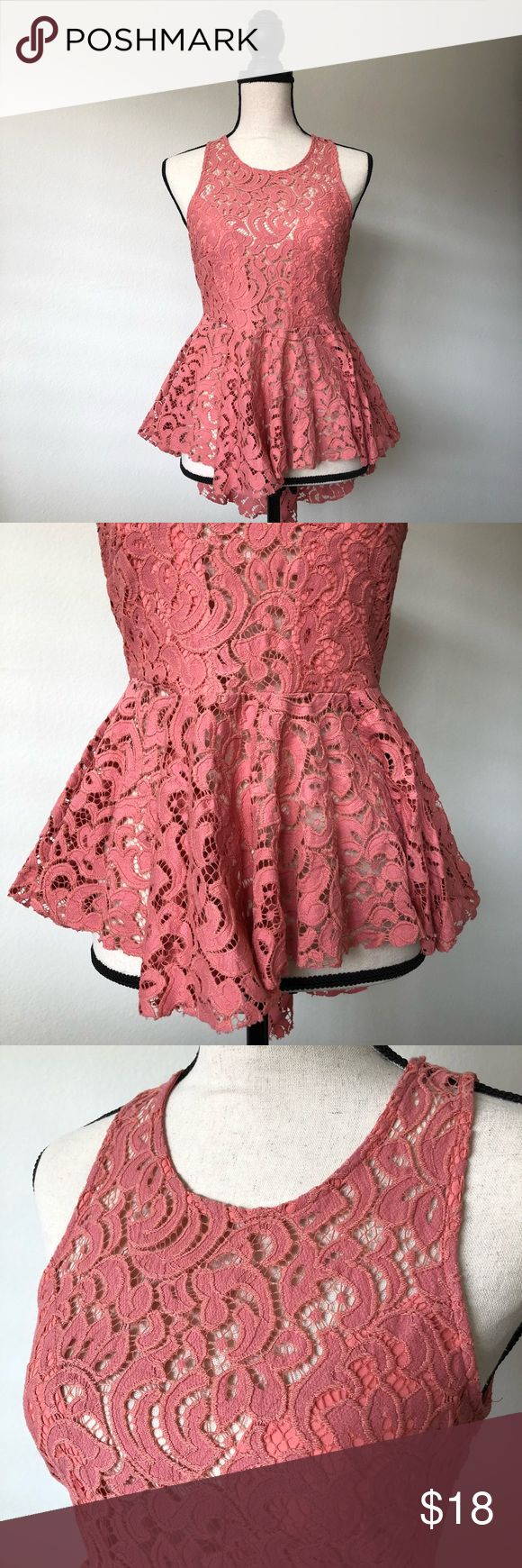 Pink Sleeveless Peplum Top from Papaya Pink Sleeveless Peplum Top  From Papaya Clothing  Lace design  Shell 1: 60% Cotton 40% Nylon Shell 2: 100% Polyester   Size Large  Slight snagging/fraying due to the type of fabric (please see last picture) Papaya Tops Blouses