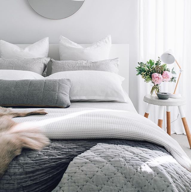 Bedroom styling by @oh.eight.oh.nine of our rectangular grey Bloomingville quilted wool cushion available online now @immyandindi webstore - tap for product details!