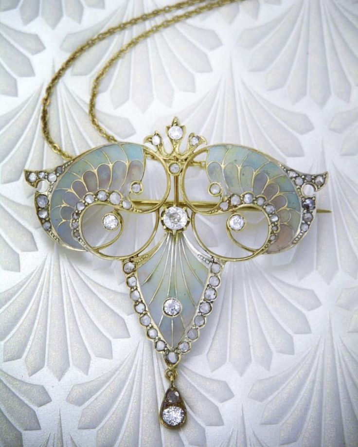 Art Nouveau gold diamond and enamel plique-a-jour pendant #artdecojewelry #GoldJewelleryArtNouveau