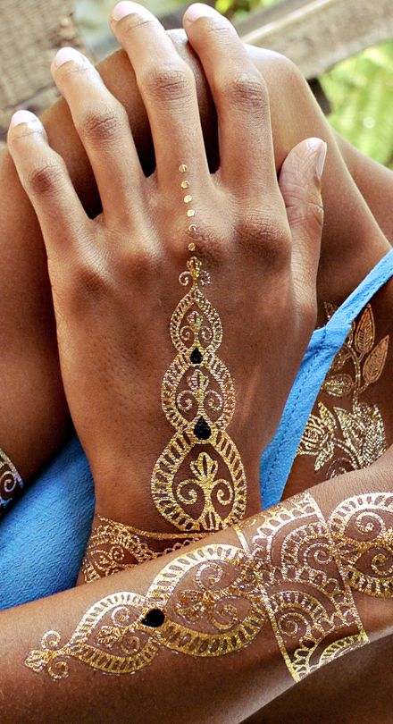 Buy some metallic temporary tats for your Coachella party, so guests can dec themselves out. Loving these wicked designs!