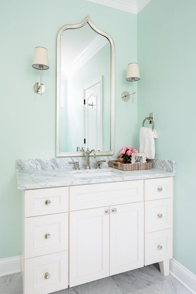 If I could have Knoxville, Tennessee interior designer Natalie Clayman come and work her magic in our bathroom, I'd be thrilled! I'd make it easy: exactly like this. What a dream space! I seriously lo